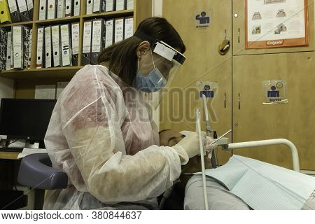 Jerusalem, Israel - August 4th, 2020: A Dental Hygienist At Work, Fully Protected Against Corona Vir