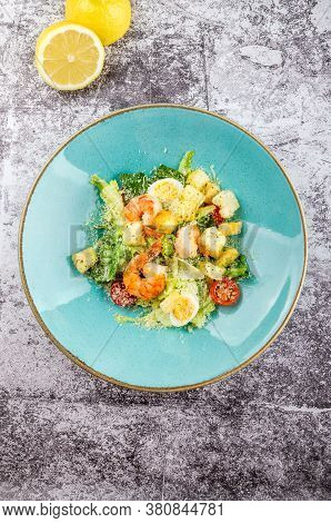 Fresh Caesar Salad With Seafood, Shrimp, Romaine Salad Leaf, Cherry Tomato, Quail Eggs And Parmesan