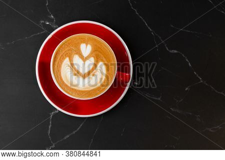 Red Cup Of Hot Latte Coffee With Beautiful Milk Foam Latte Art Texture Isolated On Dark Marble Backg