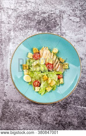 Fresh Caesar Salad With Grilled Chicken, Romaine Salad Leaf, Cherry Tomato, Quail Eggs And Parmesan