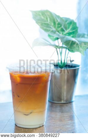 Thai Tea And Fresh Milk Mixed With Ice In The Plastic Cup At The Coffee Shop In Thailand Ready Serve