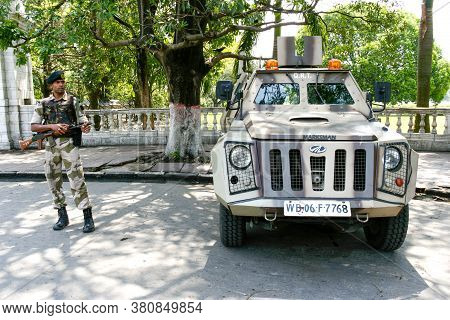 Kolkata, India - September 15, 2020 : Young Indian Soldier Guard Holding Light Machine Gun And Marks