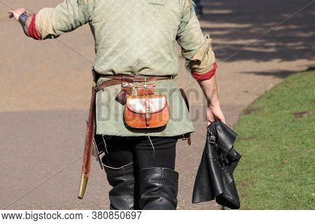 Medieval Re-enactor Wearing Boots And Various Other Pieces Of Period Leatherware