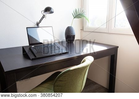Workplace With Laptop On Table At Home Near Window, Modern Interior Home Office Desk On A Sunny Day