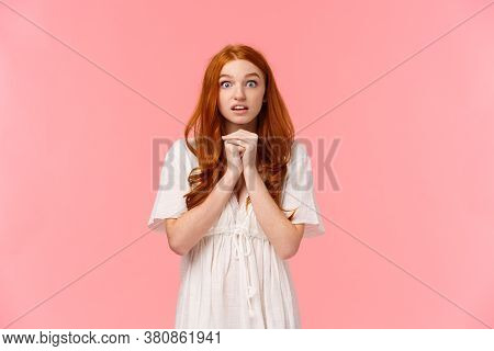 Hopeful And Amused, Redhead Female In White Dress, Holding Hands Together Over Chest In Praying Pose