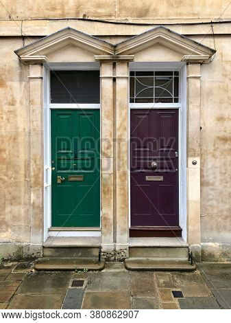 Two front doors of adjoining terraced townhouses