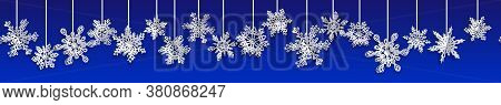 Christmas Seamless Banner With Volume Paper Snowflakes With Soft Shadows On Blue Background. With Ho