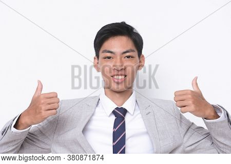 young handsome businessman  wearing in gray suit ,tie with white shirt
