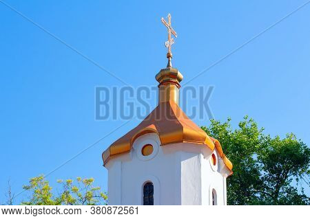 White Steeple With Cross On The Top
