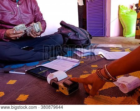 District Katni, India - January 25, 2020: An Indian Woman Giving Thumb Impression On Digital I Pad M