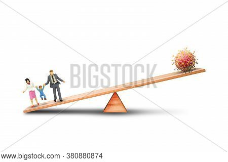 Happy Family With New Normal Concept : Family People Outweigh More Than Virus Cell On Balance Scales