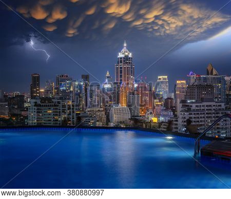 Cityscape In Bangkok City From Roof Top Bar In Hotel With Swimming Pool Background, This Image Can U
