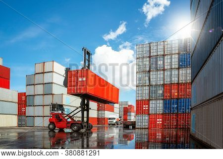 Crane Car Move And Carry Container Box From Container Stack Loading To Truck In Container Box Deposi