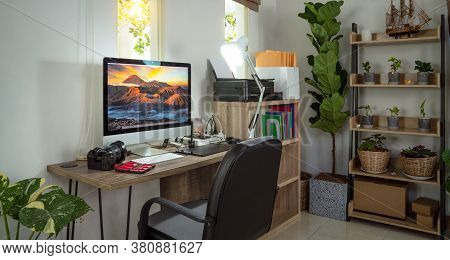 Small Homeoffice For Photographer With Plants Decor And Bromo Mt Picture On The Destop Wall Paper Of