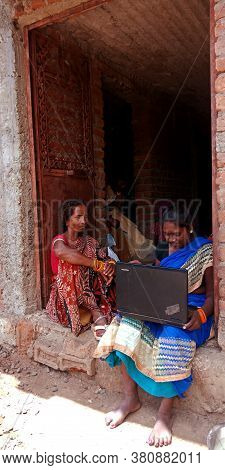 District Katni, India - August 20, 2019: Two Indian Village Women Learning About Laptop Technology T