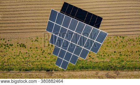 Farm Solar Sub Station. Rotating Solar Panels At The Rural Area. Small Electric Station For Covering