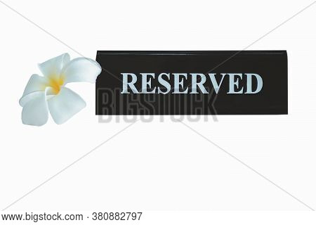 Reserved Metal Black Plate In A Restaurant. Reserved Metal Plate Isolated On White Background With C