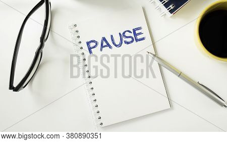 Pause Written On A Memo At The Office