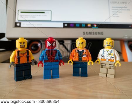 Bosnia And Herzegovina - April 9, 2020: Four Lego Toys, A Spiderman And Workers, On A Computer Desk