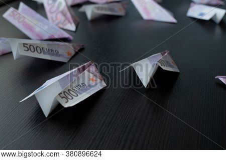 Paper Airplanes Made Of Euro Banknotes, The Concept Of Cash Flow. Global Financial Crisis, Debt On L