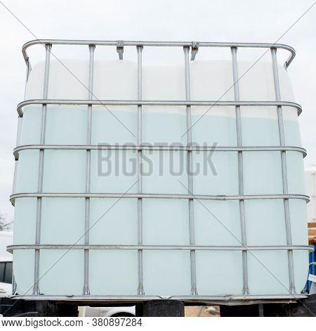 1000 Litre Intermediate Bulk Containers Liquid Storage Tank On Construction Site