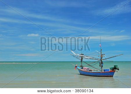 The fisherman boat and the sea