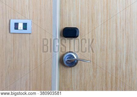 Smart Card Door Key Lock System In Hotel. Hotel Electronic Lock On Wooden Door. Entrance Door With E