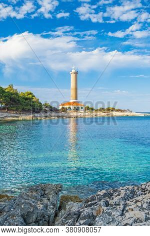 Lighthouse Of Veli Rat On The Island Of Dugi Otok, Croatia, Beautiful Seascape And Rocks In Foregrou