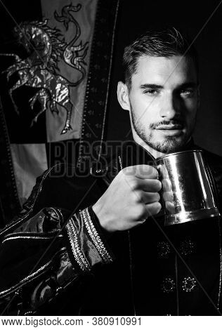 Portrait Of Handsome King With Beard Dressed In Costume With Tankard Looking At Camera