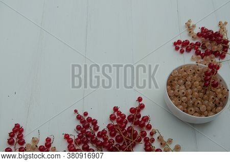Red, Black And White Currants On A Light Background. White Cup With White Currants. The View From Th