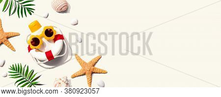 Sunblock Bottle Wearing Sunglasses With Starfish And Seashells - Flat Lay