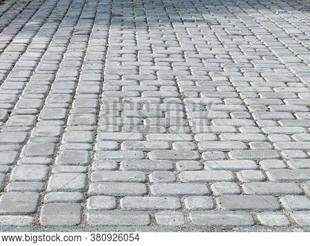 Place Paved With Paving Stones. Grey Background With Paving Stones