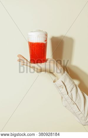 Female Hand Holding Summer Red Strawberry Cocktail Smoothie Shakes On Beige Background