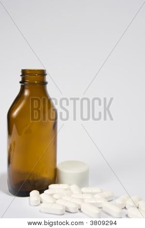 Brown Bottle And Pills