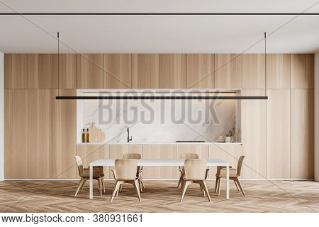 Interior Of Modern Kitchen With White Marble Walls, Wooden Floor, Cabinets And Dining Table. 3d Rend