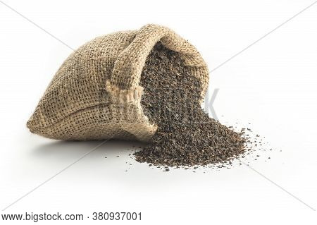 Turkish Dry Black Tea For Brew In Burlap Sack Isolated On White Background. Turkish Traditional Drie