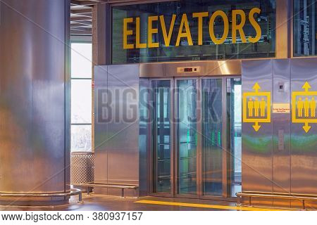 View Of The Lift Doors In The Airport Office Building. Wide Angle View Of A Modern Elevator With Gla