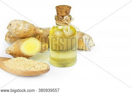 Glass Bottle Of Essential Ginger Oil, Ginger Root And Powder Isolated On White Background. Healthy F