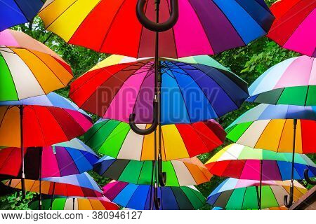Park Alley Is Decorated With Multi-colored Umbrellas. Canopy Made Of Rainbow Umbrellas.