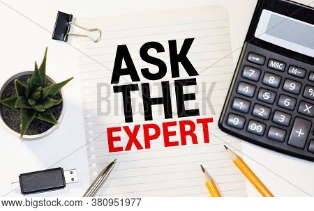 Ask An Expert. Top View Of Working Place With Ask An Expert Lettering At Notepad