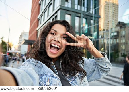 Happy African American Hipster Teen Girl Blogger Influencer Recording Vlog Holding Looking At Camera