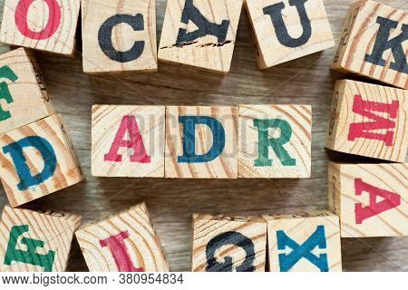 Alphabet Letter Block In Word Adr (abbreviation Of Adverse Drug Reaction) With Another On Wood Backg