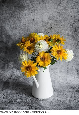 Autumn Flowers Yellow And White Dahlias Bouquet In A Vintage White Metal Jug On A Gray Background, F