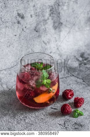 Raspberry, Peach, Mint Cocktail Lemonade Refreshing Drink On A Gray Background. Summer Cool Drinks