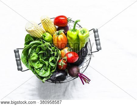 Basket Of Fresh Organic Garden Vegetables On A Light Background, Top View. Copy Space