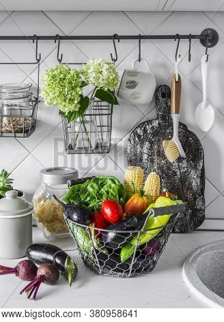 Kitchen Cozy Still Life. Basket With Fresh Vegetables In The Kitchen Interior