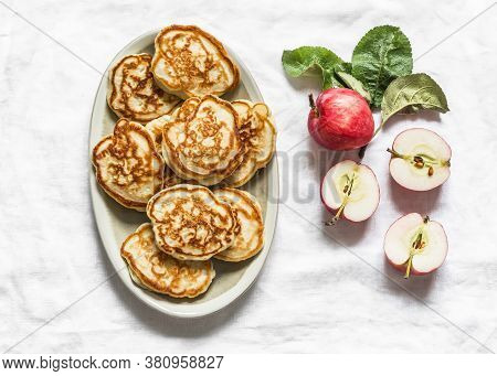 Apple Pancakes On A Light Background, Top View. Delicious Breakfast, Dessert, Snack