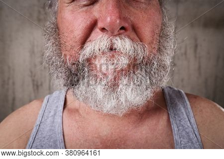 Old man with unkempt untrimmed beard