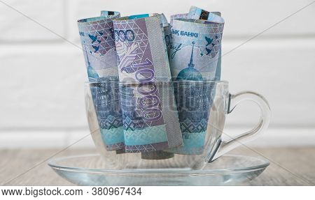 A Lot Of Money Kazakhstan Tenge In A Cup On The Table. The National Currency Of Kazakhstan. Salary I