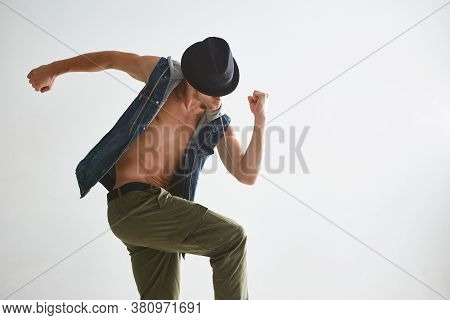 Cool Young Guy Breakdancer In Hat Dancing Hip-hop In Studio Isolated On White Background. Dance Scho